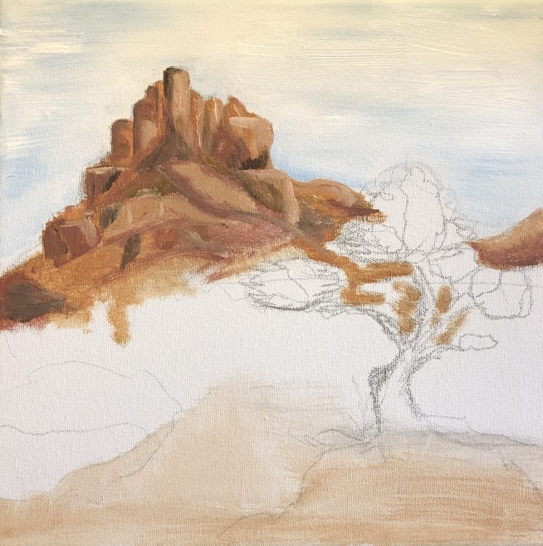 Incomplete painting of a tree perched in front of a mountain in the distance.
