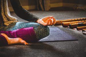 A woman sitting cross-legged practicing yoga