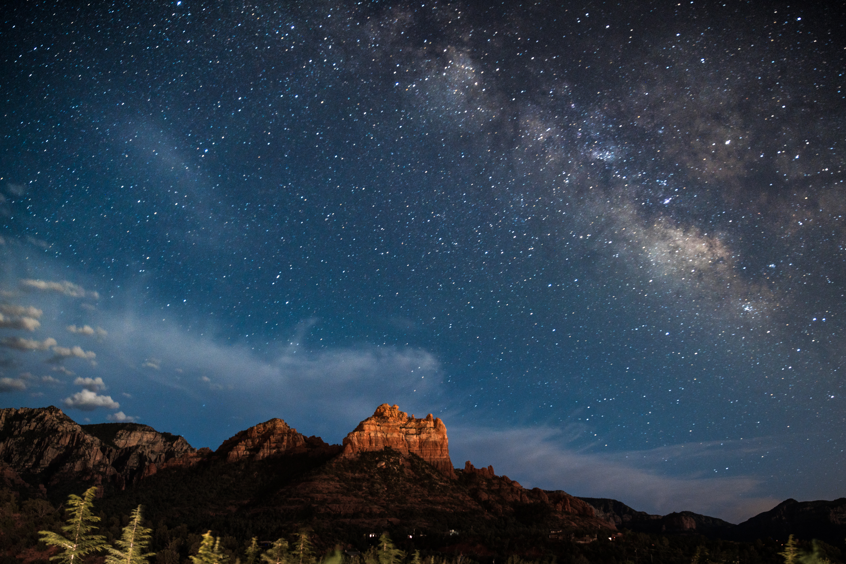 A starry night sky with mountains in the distance