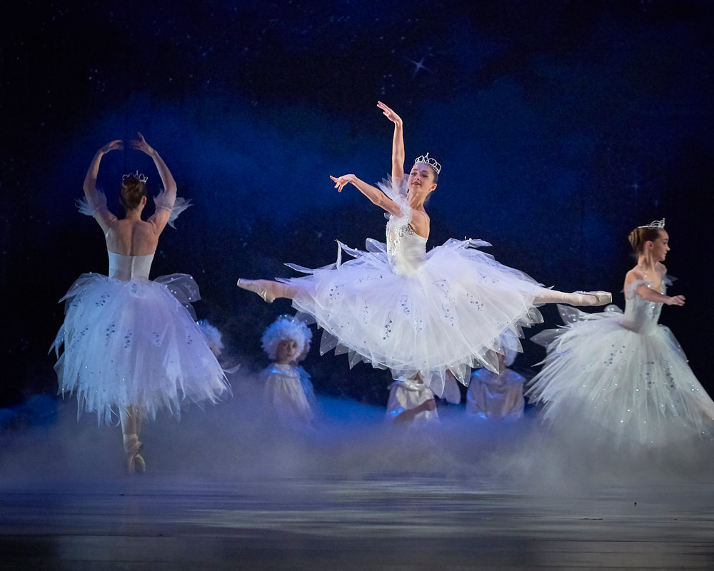 ballerinas in The Nutcracker dance and leap across a stage