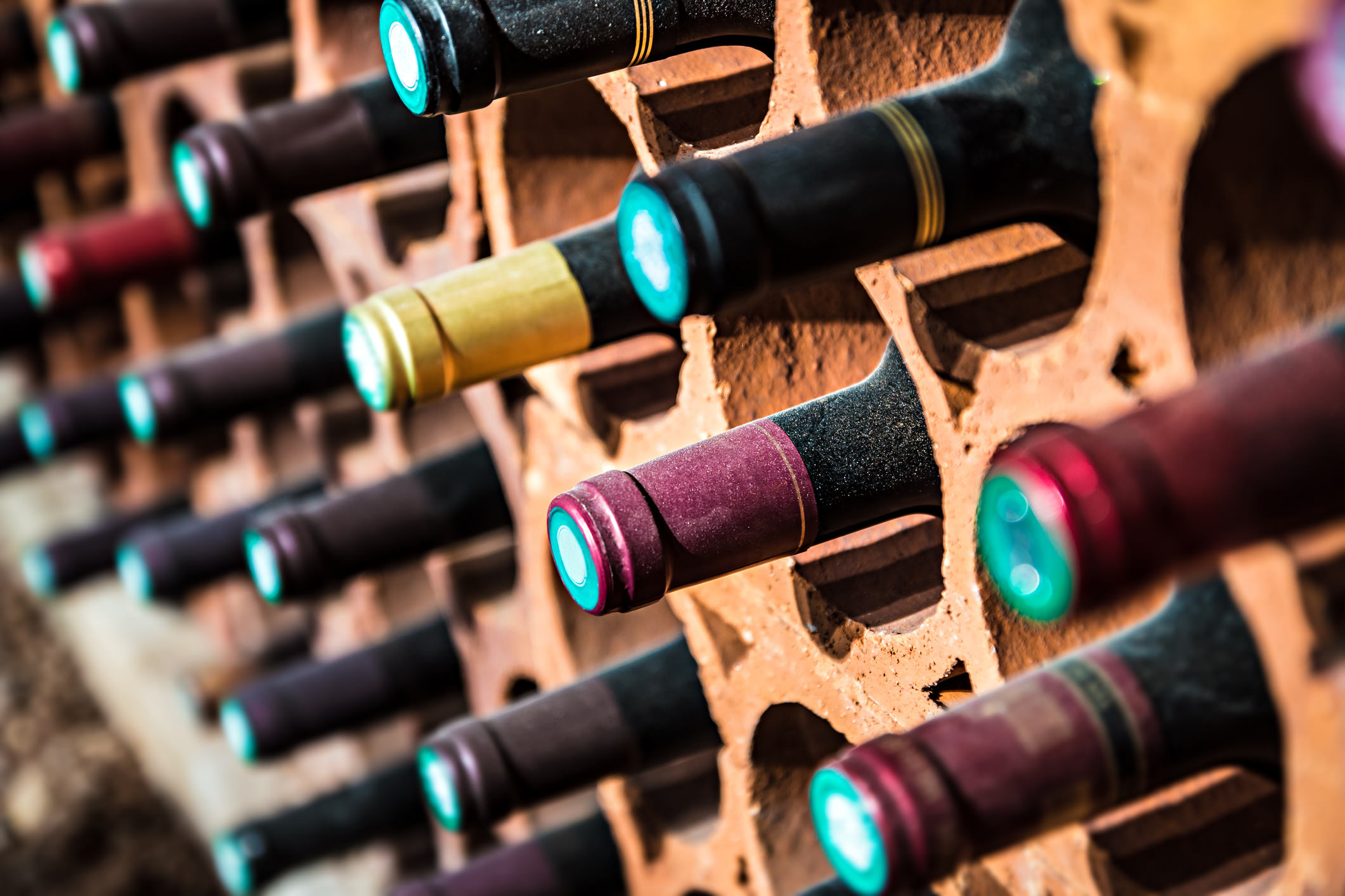 Close up view of a wine rack full of bottles.