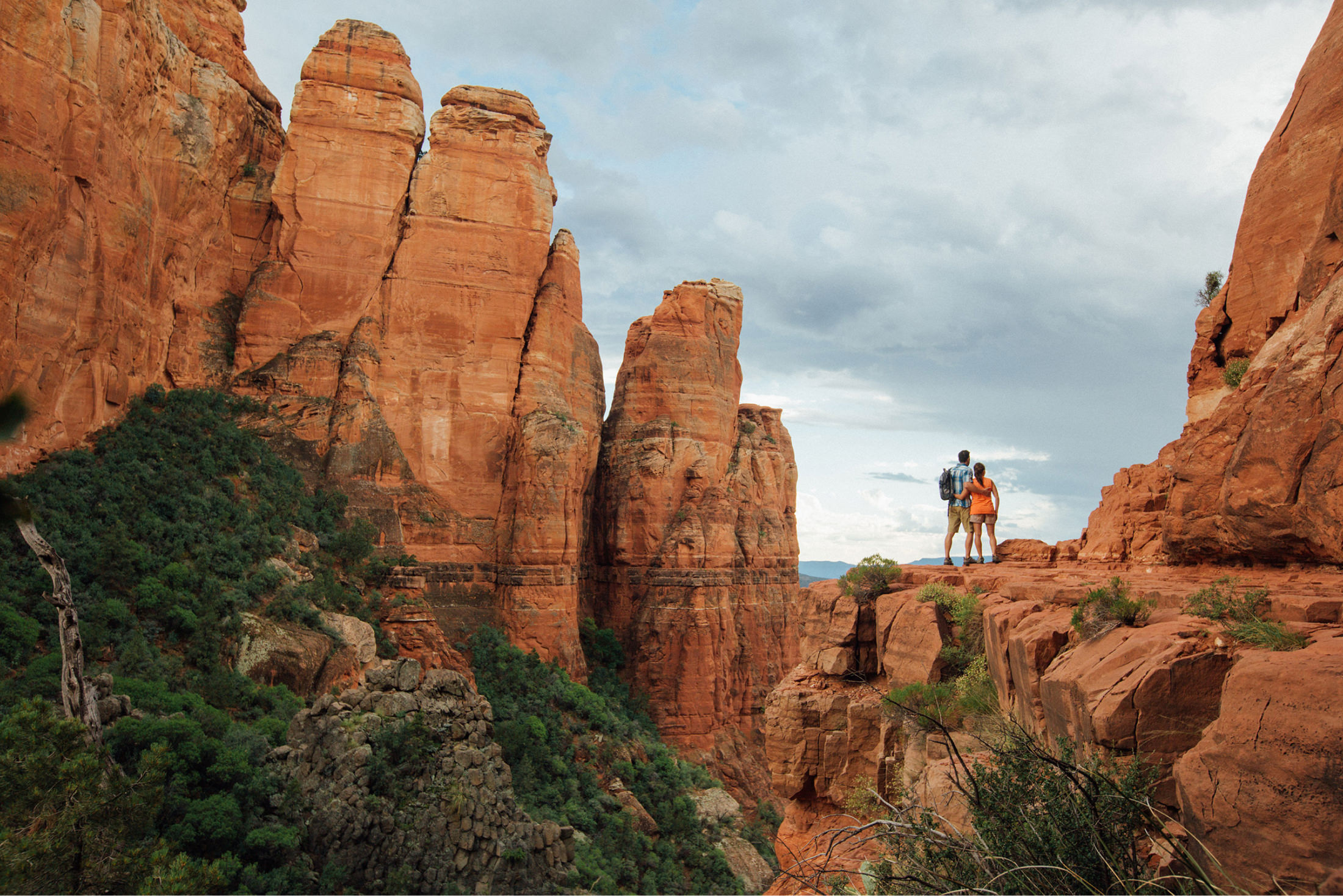 Red rock hiking couple