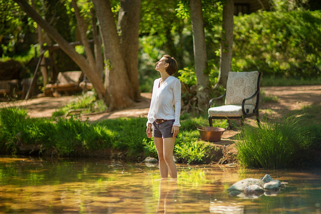 Forest Bathing - Woman standing in creek